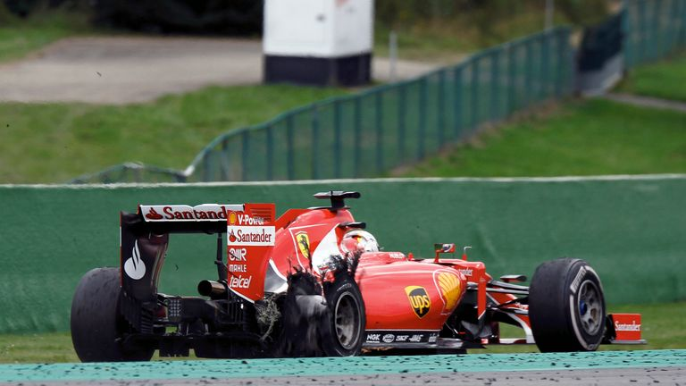 Vettel limps back to the pits after his blowout