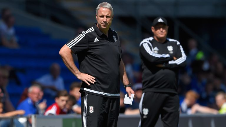 Fulham manager Kit Symons and Russell Slade of Cardiff react on the touchline