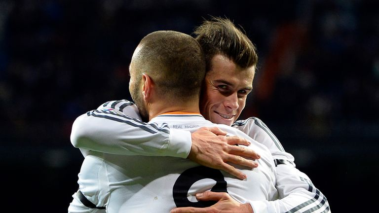 Real Madrid's French forward Karim Benzema (L) is congratulated by Real Madrid's Welsh forward Gareth Bale after scoring a goal during the Spanish league f