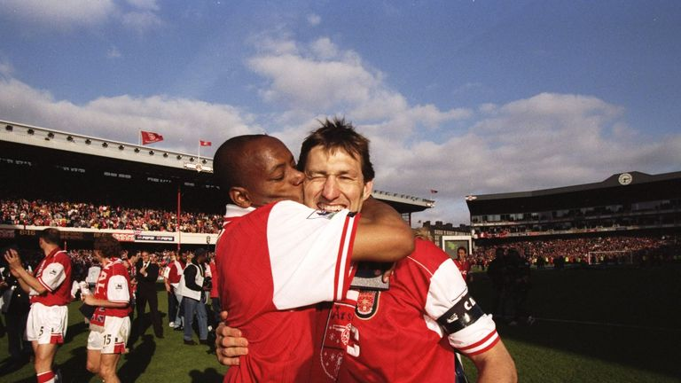 Wright kisses Arsenal captain Tony Adams after winning the Premier League title in 1998