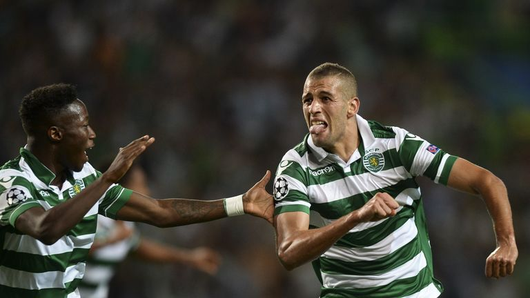 Sporting forward Islam Slimani (R) celebrates a goal with his teammate Sporting's forward Carlos Mane (L)