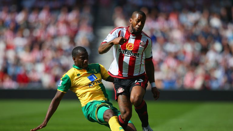 Jeremain Lens of Sunderland and Sebastien Bassong of Norwich City compete for the ball