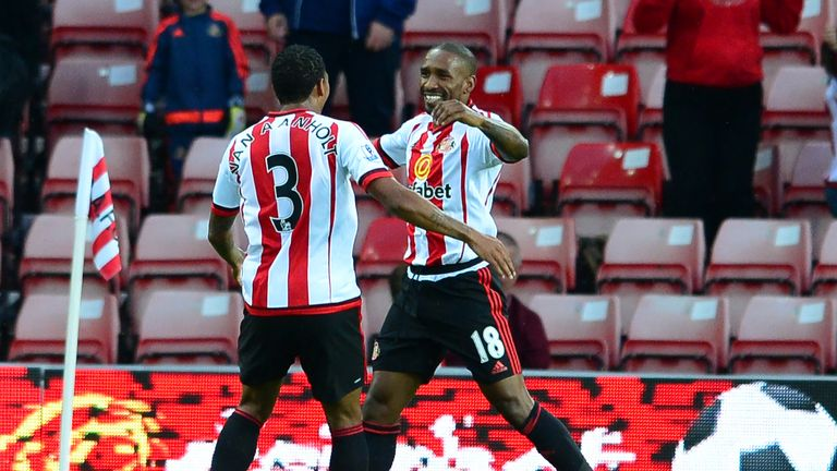 Jermain Defoe (r) celebrates scoring the opening goal with team mate Patrick Van Anholt against Exeter
