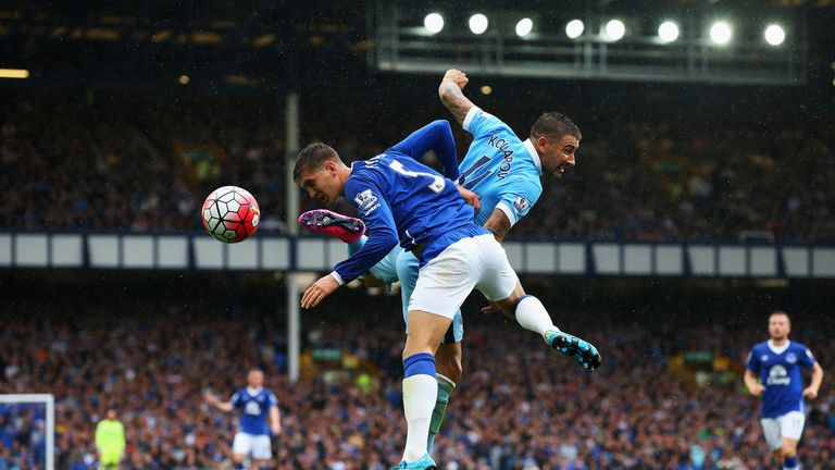 John Stones of Everton challenges for the ball with Aleksandar Kolarov of Manchester City during the Barclays Premier League at Goodison Park