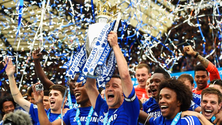 John Terry of Chelsea celebrates with the trophy after the Barclays Premier League match between Chelsea and Sunderland at Stamford Bridge on May 24, 2015