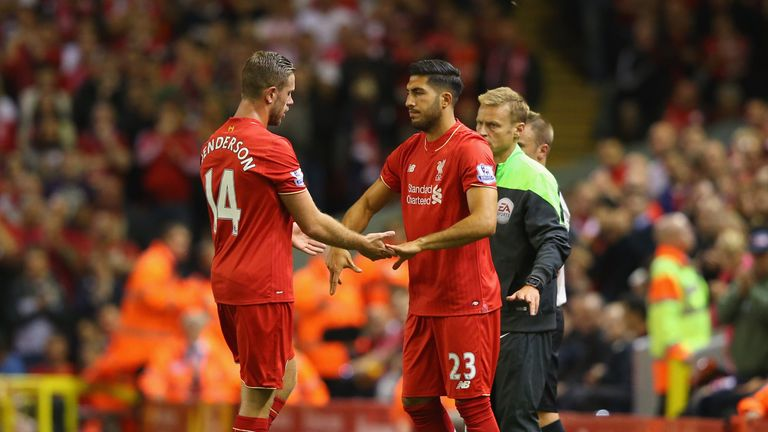 Jordan Henderson of Liverpool shakes hands with team mate Emre Can as he is substituted.