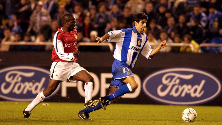 Juan Carlos Valeron of Deportivo breaks away from Lauren of Arsenal during the UEFA Champions League Group D Stage Two match in November 2001