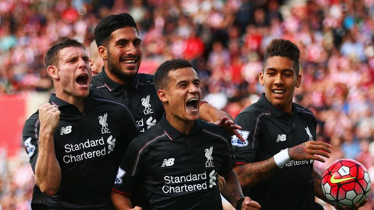 Philippe Coutinho with team-mates James Milner, Emre Can and Roberto Firmino of Liverpool