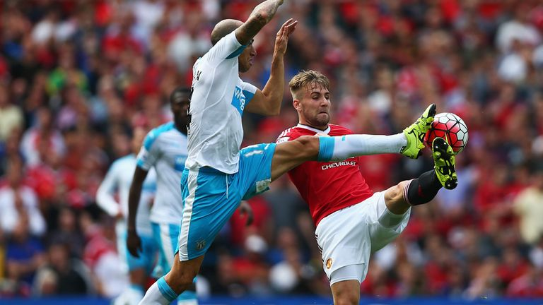 Luke Shaw of Manchester United and Gabriel Obertan of Newcastle compete for the ball