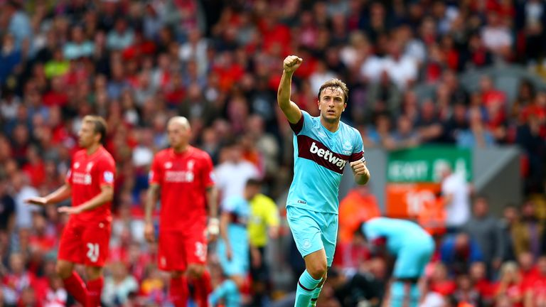 Mark Noble of West Ham United celebrates scoring his team's second goal from the penalty spot during the Barclays Premier League match at Liverpool