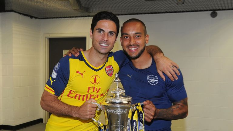 Mikel Arteta and Theo Walcott with the FA Cup Trophy after the match between Arsenal and Aston Villa in the FA Cup Final at Wembley