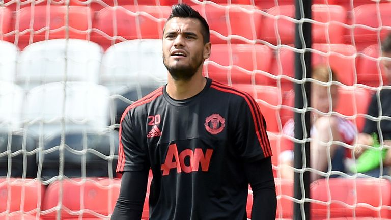 Manchester United goalkeeper Sergio Romero warms up before the match with Tottenham at Old Trafford