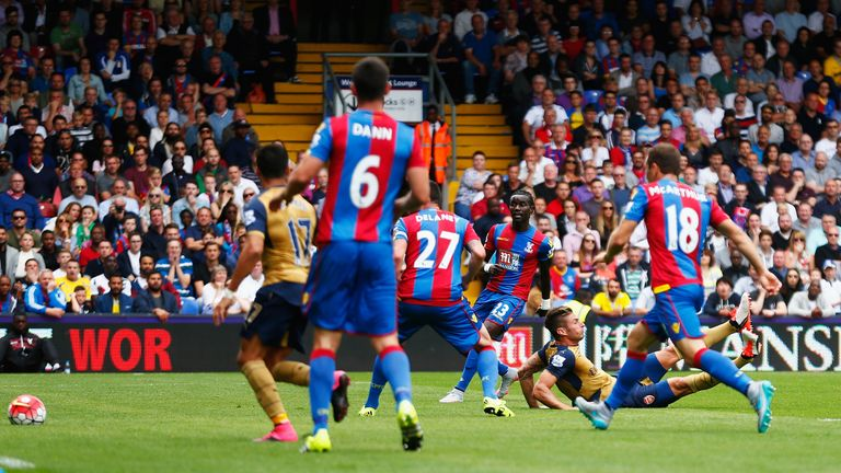 Olivier Giroud (grounded, right) hooks Arsenal in front at Crystal Palace