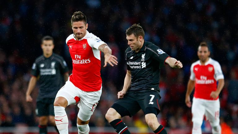 Olivier Giroud and Jame Milner battle for the ball as Arsenal host Liverpool in the Premier League