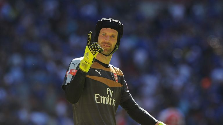 Arsenal goalkeeper Petr Cech celebrates after the Community Shield