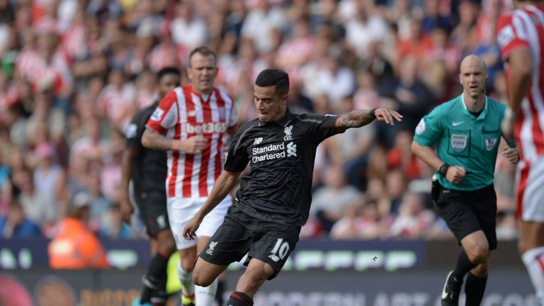 Liverpool's Philippe Coutinho shoots to score the winning goal with a trademark long-range strike in the 86th minute