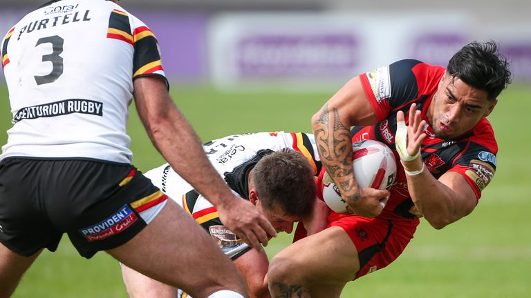 Salford's Rangi Chase is tackled by Bradford's Jake Mullaney