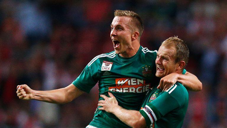 Christopher Dibon (left) and Mario Sonnleitner (right) of Rapid Vienna  celebrate against Ajax