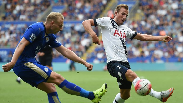 Ritchie De Laet of Leicester City and Harry Kane of Tottenham Hotspur compete for the ball