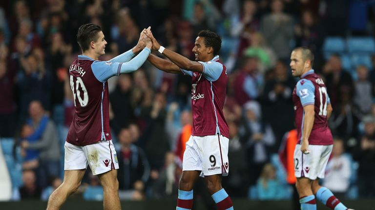 Scott Sinclair (C) of Aston Villa celebrates scoring his hat trick with Jack Grealish during the Capital One Cup second round