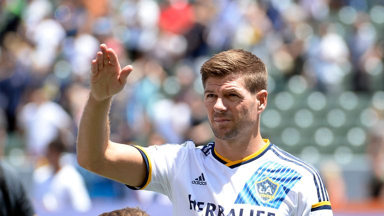 Steven Gerrard #8 of the Los Angeles Galaxy waves at his family in the owner box before the start of the MLS match between LA Galaxy and Seattle Sounders