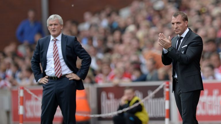 Stoke City manager Mark Hughes (left) and Liverpool boss Brendan Rodgers watch the action from the sidelines