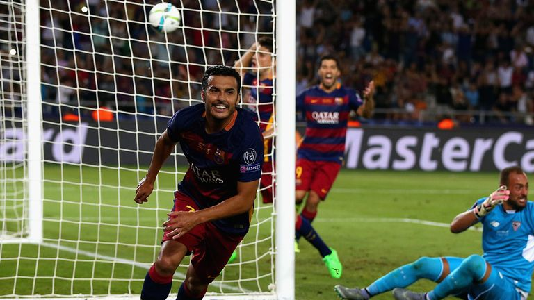 Pedro wheels away in celebration after putting Barcelona 5-4 up against Sevilla in Tbilisi