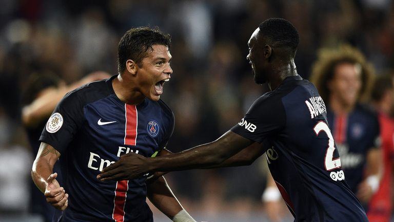 Paris Saint-Germain's Brazilian defender Thiago Silva (L) celebrates with Paris Saint-Germain's French forward Jean Kevin Augustin after scoring during the