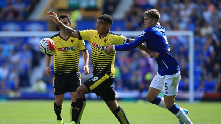 Troy Deeney of Watford and John Stones of Everton compete for the ball in the first game of the season