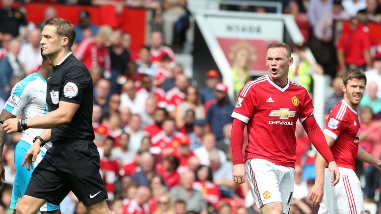 Wayne Rooney of Manchester United complains
