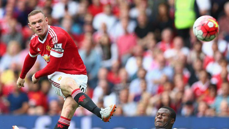 Wayne Rooney shoots on goal against Newcastle