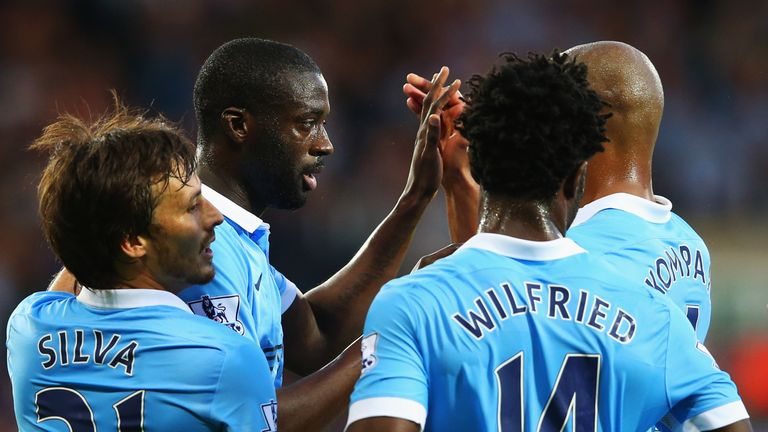 Yaya Toure of Manchester City (2L) celebrates with team mates David Silva (L), Wilfred Bony (2R) and Vincent Kompany (R) as he scores their second goal