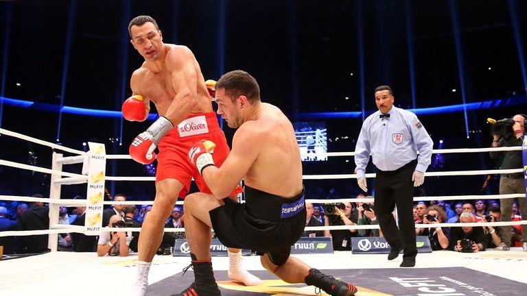 Wladimir Klitschko (R) of Ukraine exchanges punches with Kubrat Pulev (L)