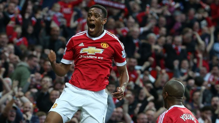 Anthony Martial of Manchester United celebrates scoring their third goal during the Barclay's Premier League match between Manchester United and Liverpool