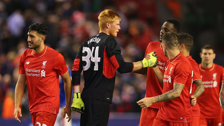 Adam Bogdan of Liverpool celebrates with team mates after saving the crucial penalty against Carlisle
