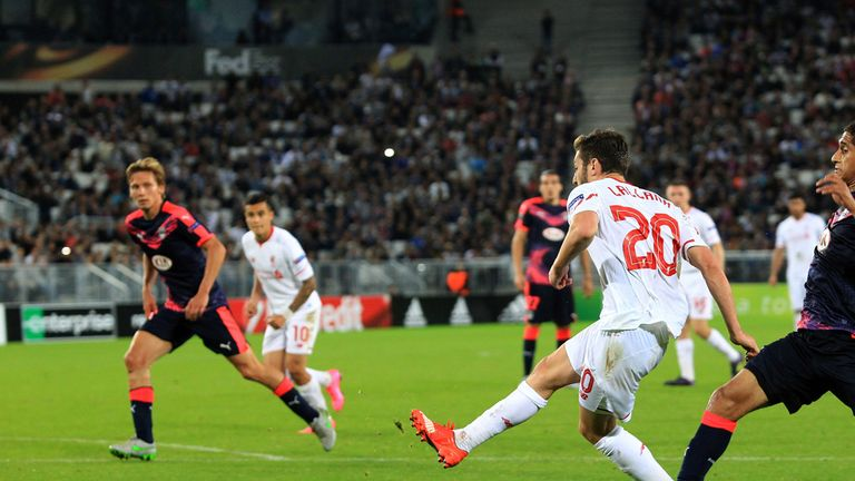 Liverpool's Adam Lallana shoots to score against Bordeaux