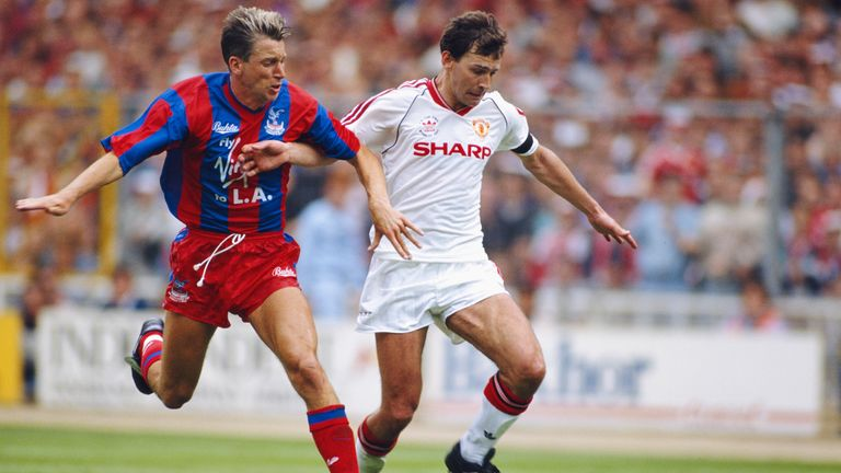 Crystal Palace player Alan Pardew challenges Bryan Robson during the 1990 FA Cup final between Crystal Palace and Manchester United at Wembley Stadium