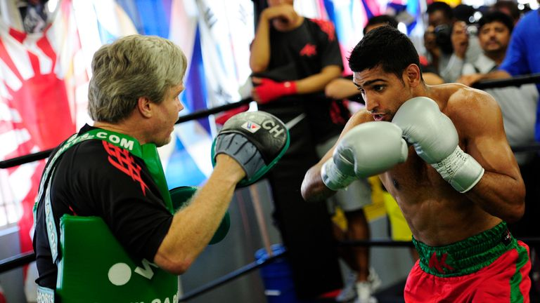Khan split with Freddie Roach three years ago after back-to-back defeats against Lamont Peterson and Danny Garcia
