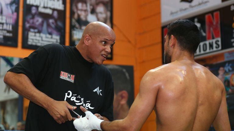 Amir Khan's trainer Virgil Hunter (left) wants to see his fighter take on Kell Brook