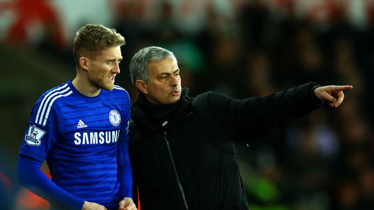 Jose Mourinho, manager of Chelsea speaks with Andre Schurrle
