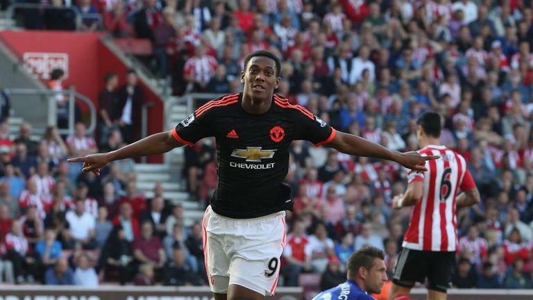 Anthony Martial celebrates scoring his second goal