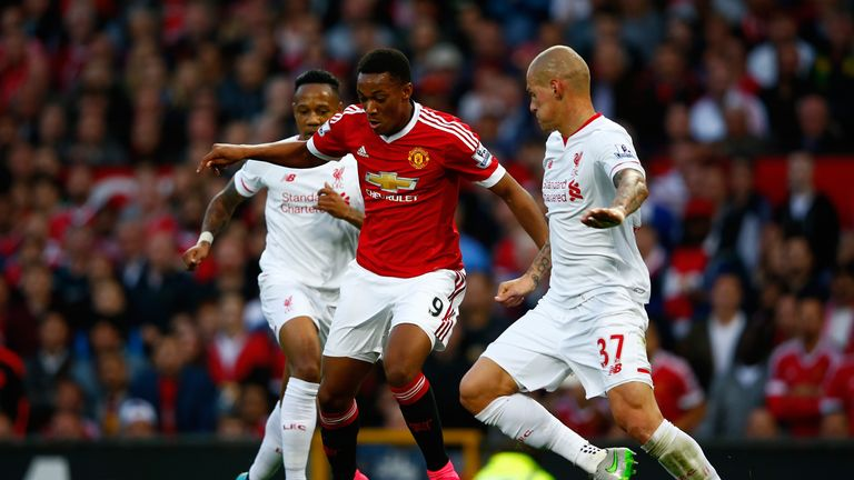 Anthony Martial of Manchester United takes on Nathaniel Clyne (L) and Martin Skrtel of Liverpool during the Barclays Premier League match at Old Trafford
