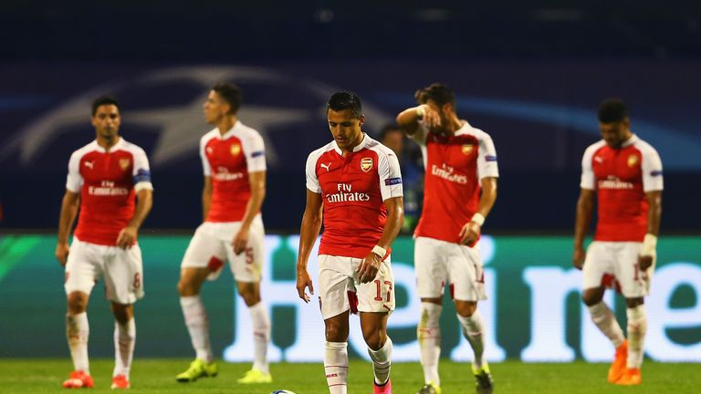 Alexis Sanchez of Arsenal looks dejected with team-mates