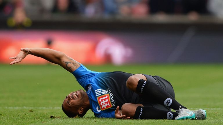 Callum Wilson of Bournemouth is taken off on a stretcher against Stoke