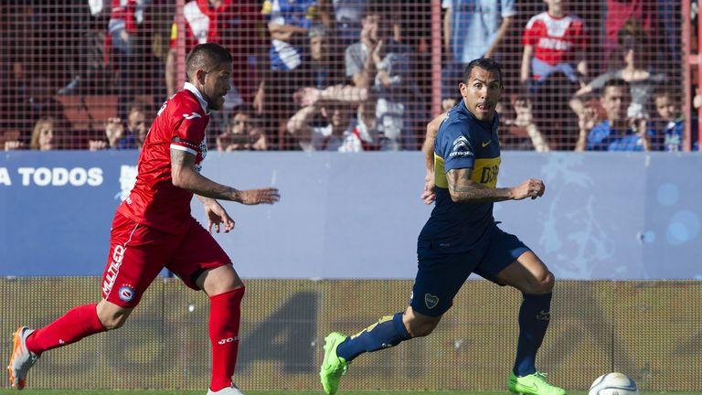 Carlos Tevez (right) in action for Boca Juniors against Argentinos Juniors