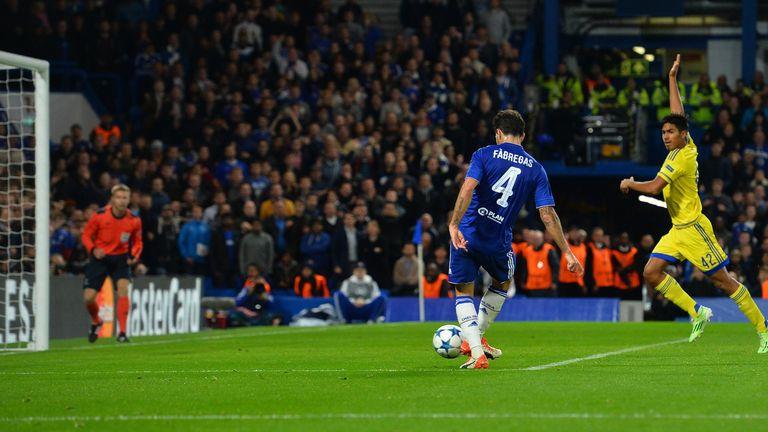 Maccabi Tel Aviv midfielder Dor Peretz (R) call for off-side as Chelsea's Cesc Fabregas (C) shoots to score his team's fourth goal
