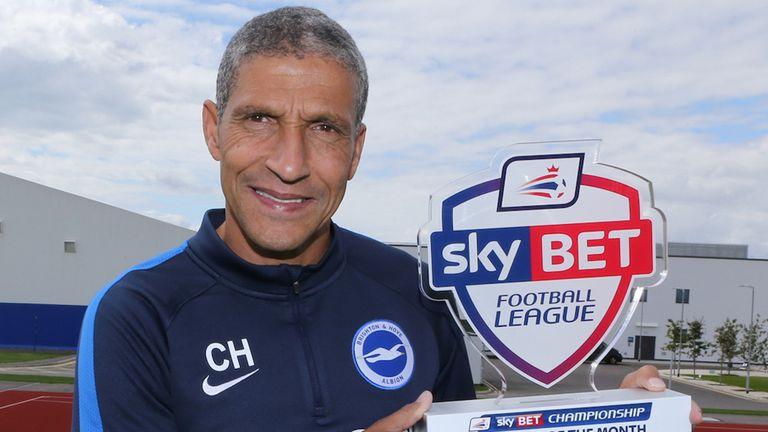 Brighton boss Chris Hughton is celebrating too