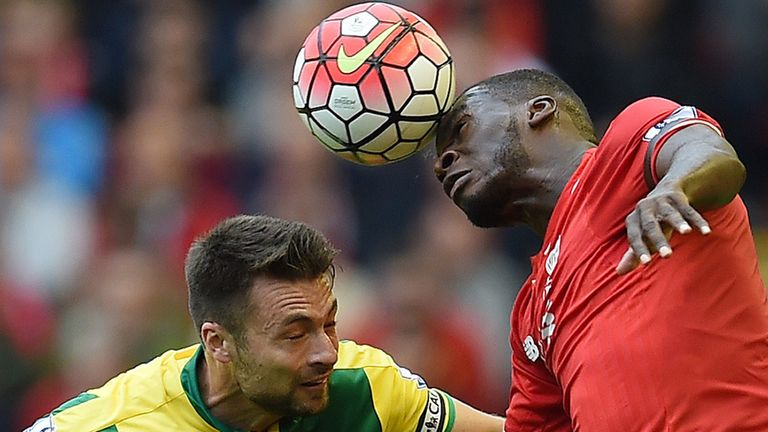 Christian Benteke vies for the ball against Russell Martin