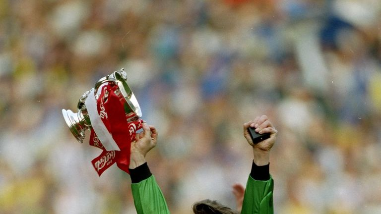 1993:  Arsenal goalkeeper David Seaman celebrates with the trophy after their victory in the Coca Cola Cup final against Sheffield Wednesday at Wembley