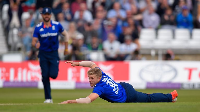England bowler David Willey celebrates after dismissing Australia batsman Aaron Finch